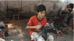 Kid_making_shoes_in_the_street